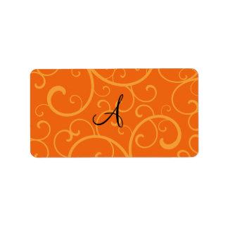 Remolinos del naranja del monograma etiquetas de dirección