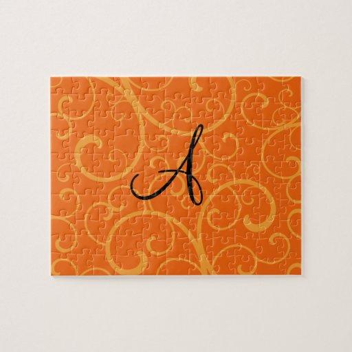 Remolinos del naranja del monograma puzzle con fotos
