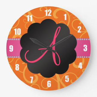 Remolinos del naranja del monograma reloj