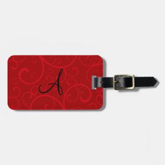 Remolinos del rojo del monograma etiqueta de maleta