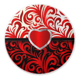 Remolinos florales rojos, blancos y negros pomo de cerámica