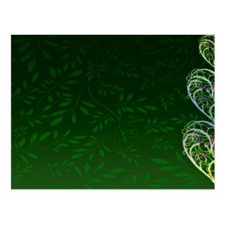 Remolinos verdosos inspiradores y hojas postal