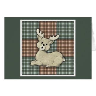 Reno del navidad en el edredón de la tela escocesa tarjeta de felicitación