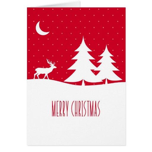Reno del navidad en nieve bajo rojo de la luna tarjeta de felicitación