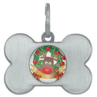 Reno en el ejemplo de la guirnalda del navidad placas de nombre de mascota