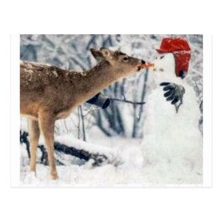 Reno que come el muñeco de nieve postal