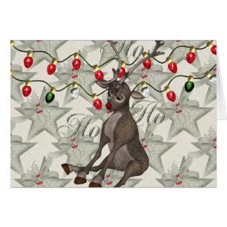Reno y luces de navidad tarjeta de felicitación