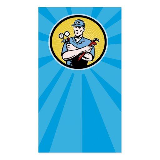 repairman serviceman holding ac manifold gauge wre business card