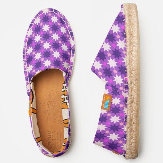 Repeating stars pattern on purple espadrilles