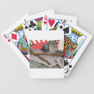 Replicas of medieval helmets , crossbows , shields bicycle playing cards