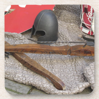Replicas of medieval helmets , crossbows , shields drink coaster