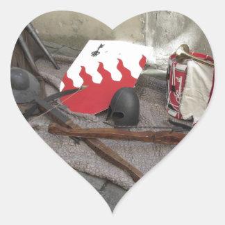 Replicas of medieval helmets, crossbows, shields heart sticker