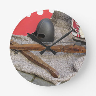 Replicas of medieval helmets , crossbows , shields round clock