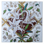 """Repro 1880s Victorian Lilies Transferware Tile<br><div class=""""desc"""">Transferware tiles were originally produced using a decorative technique that was developed in England in the mid-1700s. Although transferware designs were sometimes filled in with color glazes by hand, the design was first fired onto the tile, which made decorative tiles and other items printed using this method more affordable than...</div>"""