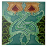 "Repro Antique Richards Art Nouveau Floral Majolica Ceramic Tile<br><div class=""desc"">Reproduction of an early 1900s molded tile by Henry Richards in a deep aqua toned blue and old rose with a patterned background in two shades of green.</div>"