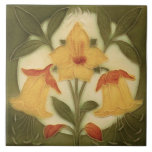 """Repro Art Nouveau Tubelined Daffodil Trio Ceramic Tile<br><div class=""""desc"""">Reproduced from a circa 1900 art nouveau tube lined tile,  which means that the original tile has raised outlines. This tile,  however is flat and smooth and only looks dimensional. A very cheerful looking trio of yellow and orange daffodils against a cream circle set into the green background.</div>"""