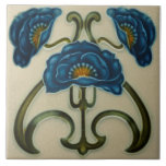 """Repro Blue Poppies Art Noveau Ceramic Tile<br><div class=""""desc"""">This is a copy of an art nouveau floral tile from the early 1900s. Richly colored in shades of blue and green with orange accents at center of each of the three flowers. Art Nouveau tiles are highly collectible and make great wall tiles trivets, coasters, decorative accessories, and, of course,...</div>"""