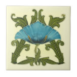 "Repro Minton Art Nouveau Ceramic Blue Floral Tile<br><div class=""desc"">The original tile featuring this art nouveau design was produced by Minton Tile Company in England. Minton was considered one of the premier ceramics manufacturers of the mid-19th through early 20th centuries. This symmetrical sophisticated floral design is in the original gorgeous shades of blues with greens and a touch of...</div>"