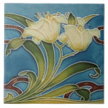 """Repro Minton China Glazed Art Nouveau Lily Border Ceramic Tile<br><div class=""""desc"""">A beautiful art nouveau tile featuring lilies that is reproduced from a circa 1900 Minton tile. This tile was hand-glazed in gold, maroon, cream, and green against a blue background. Makes a great border tile or backsplash tiles! You can see how this tile looks as a border in our media...</div>"""