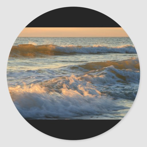 Resaca de la puesta del sol pegatina redonda