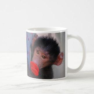 Rescued Baby Ape with a dummy Coffee Mug