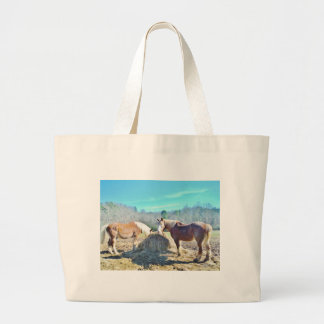 Rescued Draft Horses eating hay Canvas Bags