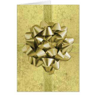 Resembles a Gold Foil Christmas Present Card