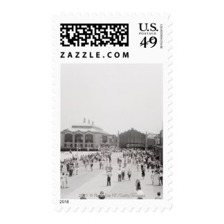 Resort tourists on esplanade stamp
