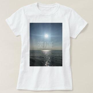 Respire la camisa de la puesta del sol