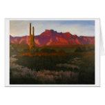 Resplandor de la puesta del sol del desierto felicitacion