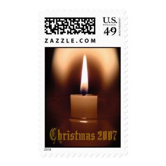Resplandor de la vela del navidad envio
