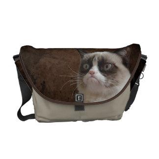 Resplandor gruñón del gato bolsas de mensajeria