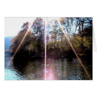 Resplandor solar sobre el río del remache, sudoest tarjeton