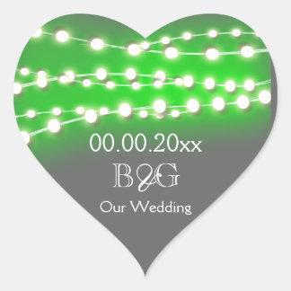 Resplandor verde del jardín de las luces de la pegatina en forma de corazón