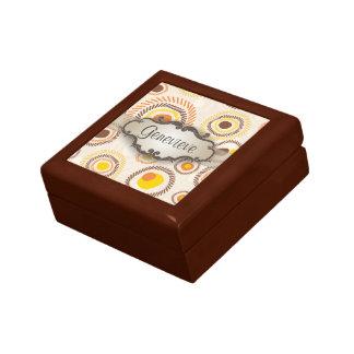 Resplandores solares de oro con el letrero cajas de recuerdo