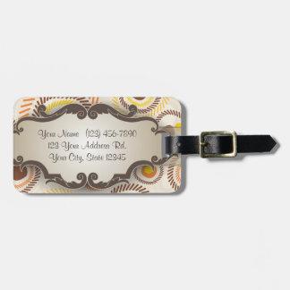 Resplandores solares de oro con el letrero etiqueta para maleta