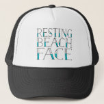 "Resting Beach Face Summer Trucker Hat<br><div class=""desc"">Show off your resting beach face this summer with our super cute typography trucker hat. Our funny play on the &quot;RBF&quot; catchphrase features the quote &quot;Resting Beach Face&quot; in black and pool aqua lettering. Cute and trendy hat makes a unique gift for the pop culture lover in your life.</div>"