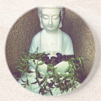Resting Buddha holding candle and plants coaster