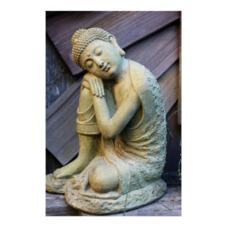 Resting Buddha Statue against Wood Fence Poster