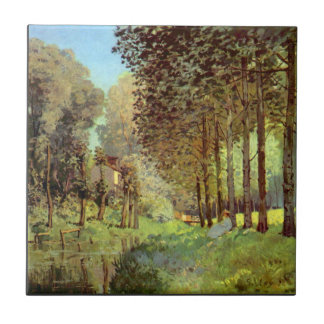 Resting on the river bank by Alfred Sisley Tile
