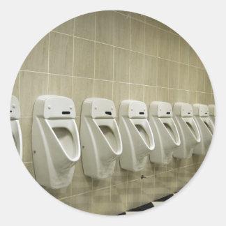 restroom interior with urinal row classic round sticker