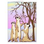 Resuelva los meerkats, familia en la nieve tarjeton