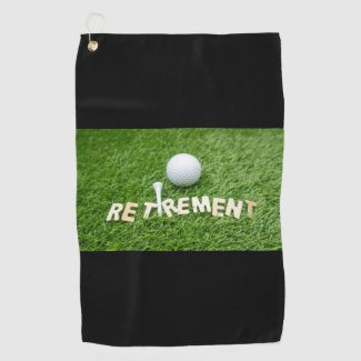 Retirement with golf ball on green Golf Towel