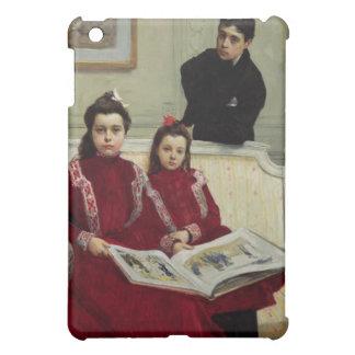 Retrato de la familia de un muchacho y sus dos Sis