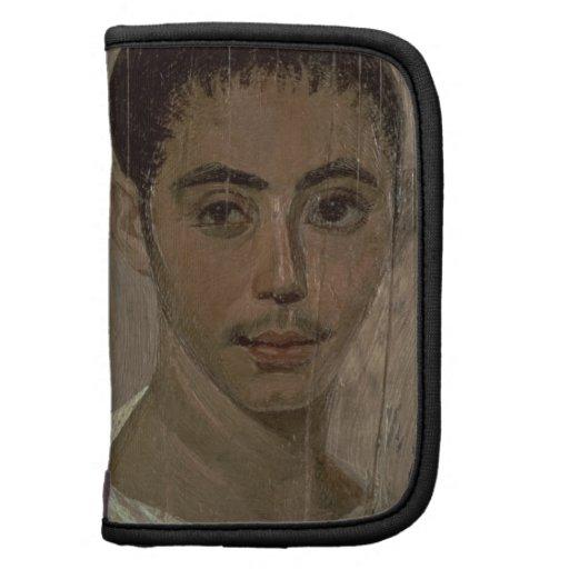 Retrato de la momia de un muchacho con un ojo heri organizadores
