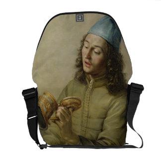 Retrato de un hombre joven que sostiene un tanque  bolsas de mensajeria