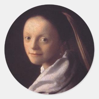 Retrato de una mujer joven pegatina redonda