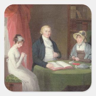 Retrato del grupo en una tabla de la sala de estar pegatina cuadrada