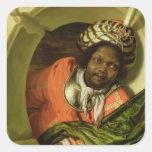 Retrato Moor que celebra una bandera en una Colcomanias Cuadradases