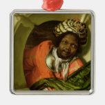 Retrato Moor que celebra una bandera en una ventan Adorno De Reyes